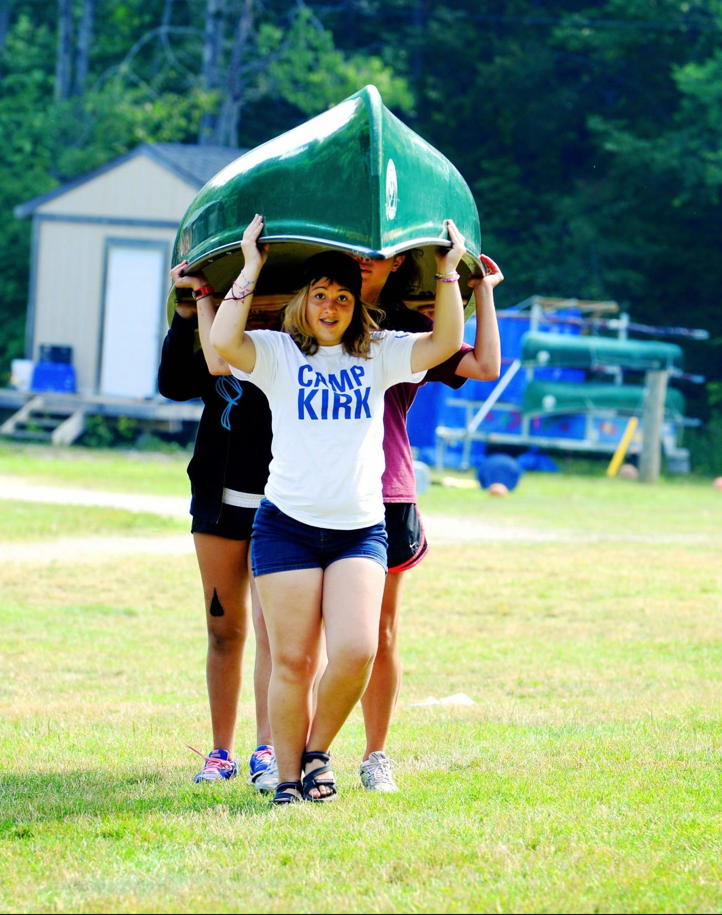 Campers portaging a canoe