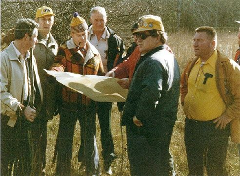 Lions Clubs members survey the site where Camp Kirk is now located