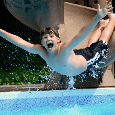 Boy with ADHD sliding into the pool