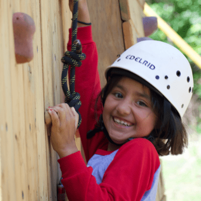 Girl with learning disability climbing the rockwall
